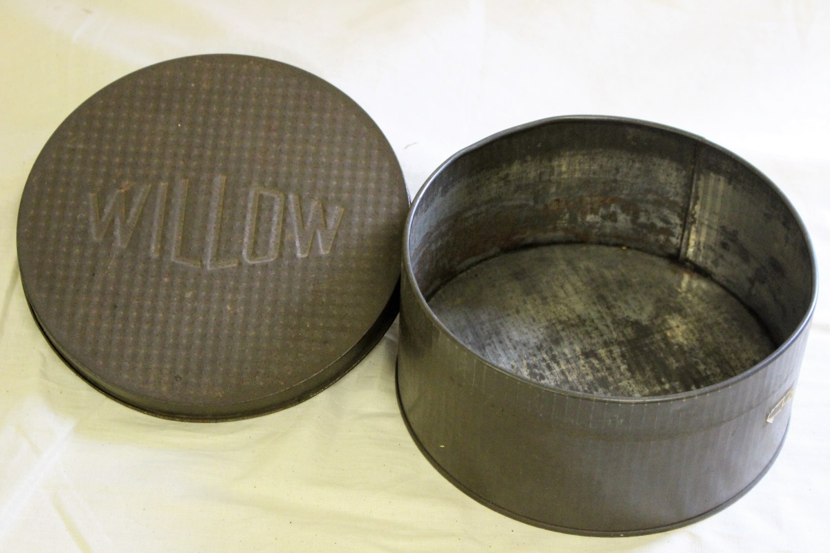 Inside Our Collection - The much travelled Willow Christmas cake tin and 'postal bag'